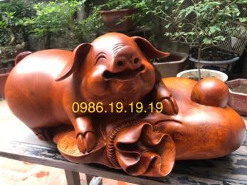 Tượng Heo Tài Lộc gỗ hương Kbang